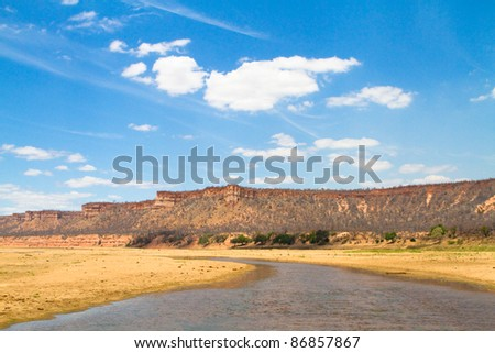 A photo of the Runde River flowing past the stunning Chilojo Cliffs in Gonarezhou National Park, ZImbabwe - stock photo