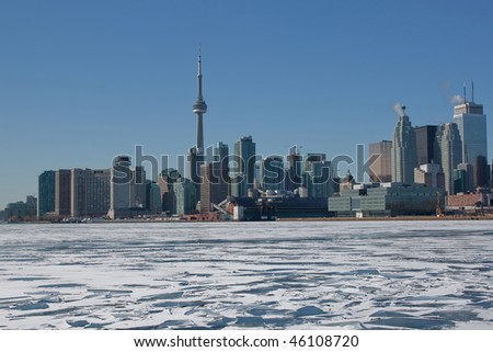 A photo of the Toronto Skyline with a frozen Lake Ontario