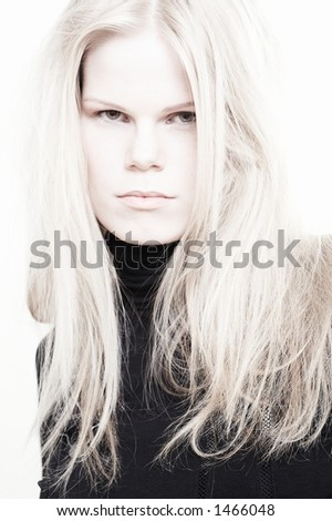 A photo of the woman with long light hair. The photo is made in a high key. By Elle Nova