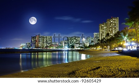 A photo of  Waikiki at night in moon light, Hawaii