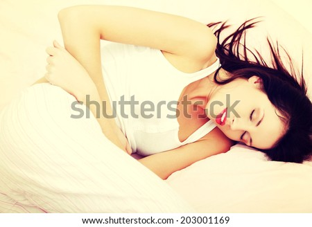 A photo of woman with stomach ache. Illness concepion. - stock photo
