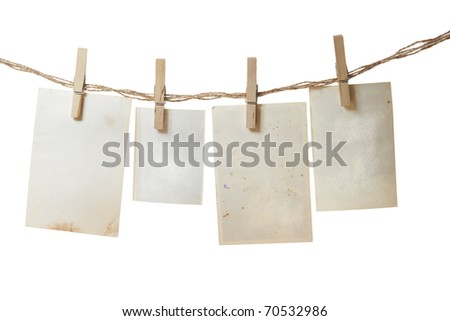 a photo pages on the rope with clothespins on white - stock photo