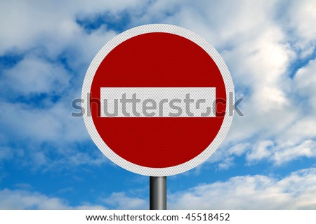 A photo-realistic metallic, reflective 'no entry' sign, against a blue sky with white fluffy clouds. Sign is perfectly circular. - stock photo