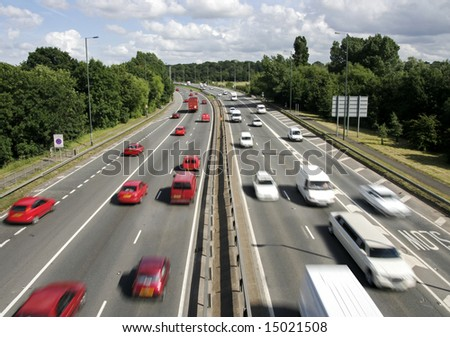 A photo showing the same colours on a motorway that you would see at night.  Red going, and white approaching. - stock photo