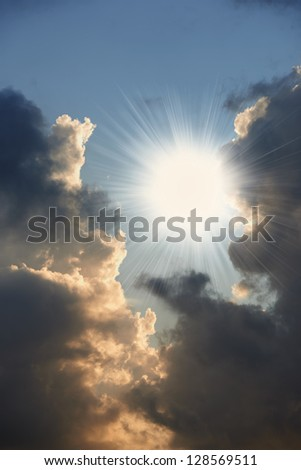 A photo sun, black cloud and orange  reflection - stock photo