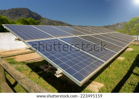 A photo voltaic solar power installation in a rural area of South Africa, utilizing the abundance of sunlight energy in summer.  - stock photo