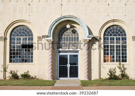A photograph of a arched entrance to a historic building storefront.