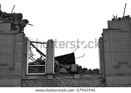 A photograph of a building exterior during the demolition process. - stock photo