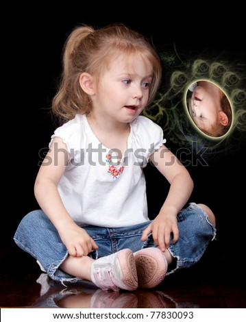 A photograph of a cute child who is talking to her imaginary friend.