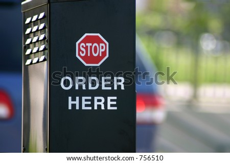A photograph of a fast food ordering speaker taken in Oklahoma City. - stock photo
