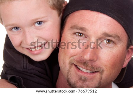 A photograph of a father and his son. - stock photo