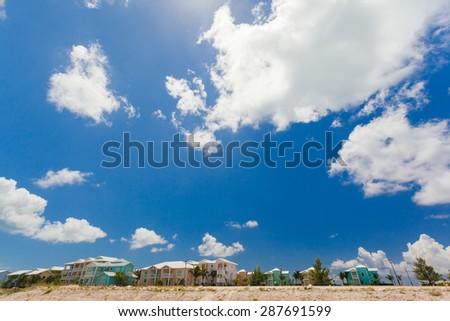 A photograph of colorful houses along the coast under an infinite sky - stock photo