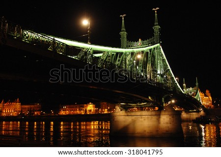 A photograph of Liberty Bridge at night in Budapest, Hungary. - stock photo