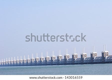 A photograph of part of the Dutch Delta Works - the Eastern Schelde storm barrier. - stock photo