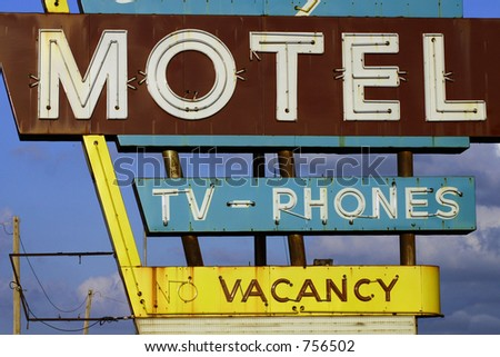 A photograph taken of a vintage motel sign in Oklahoma City. - stock photo