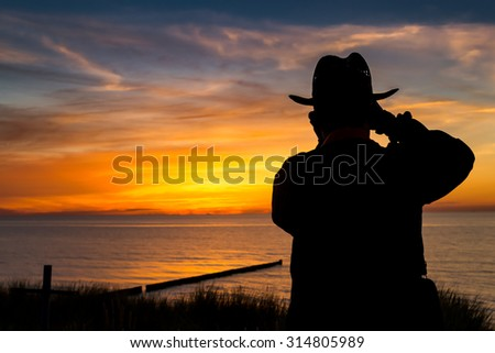 A photographer in beautiful sunset on seaside