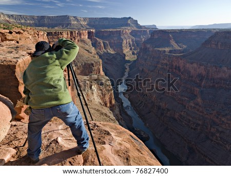 A Photographer taking a picture at Toroweap Point in the Grand Canyon