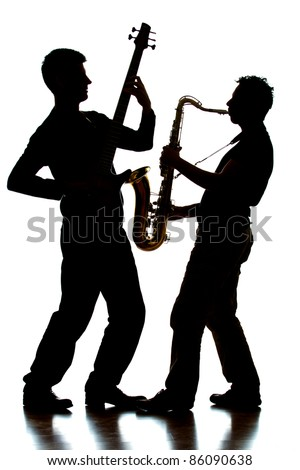 A photographic silhouette of a bass player and saxophonist jamming together - stock photo