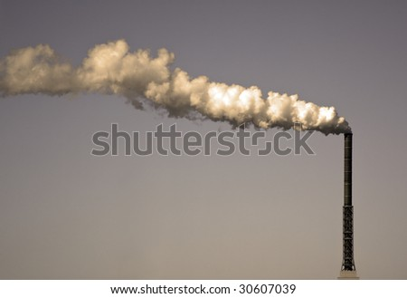 A photography of a dirty smoke stack - stock photo