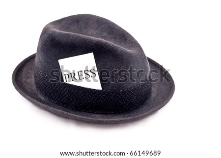 A photojournalist fedora hat with press card - stock photo
