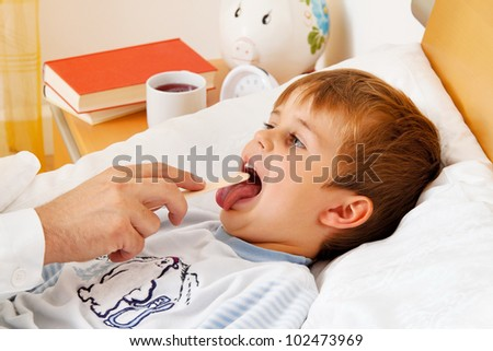 a physician house call. examines a sick child. - stock photo