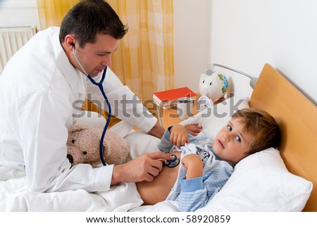 A physician house call. Examines sick child. - stock photo