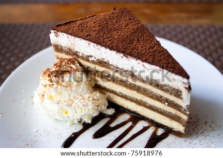A pice of cake on a white dish. - stock photo
