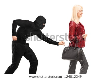 A pickpocket with mask trying to steal a from a woman carrying a purse isolated on white background - stock photo