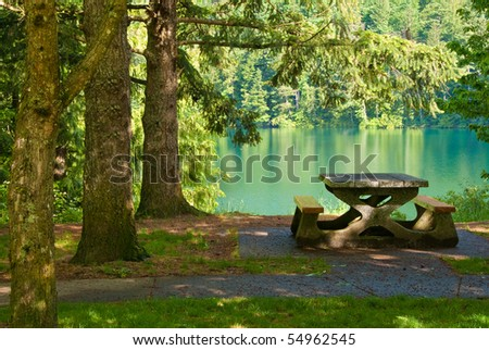 A picnic table with gorgeous view at Lake Of The Woods, British Columbia, Canada. - stock photo
