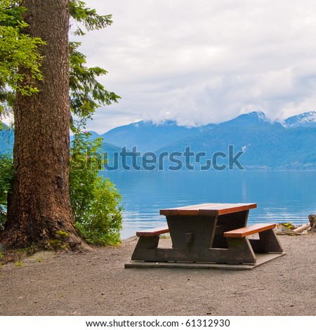 A picnic table with gorgeous view at the ocean. - stock photo