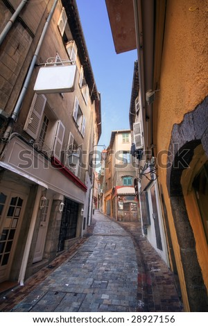 A pictoresque street of the Old Cannes with typical french shops - stock photo