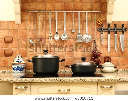 A picture of a beautiful new yet not modern kitchen, nice bright colors - stock photo