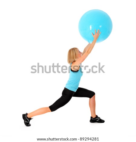 A picture of a beautiful young fit woman exercising with a ball over white background - stock photo