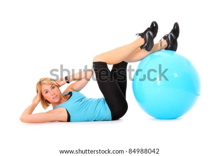 A picture of a beautiful young woman doing sit-ups with a ball over white background