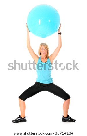 A picture of a beautiful young woman working out with a ball over white background