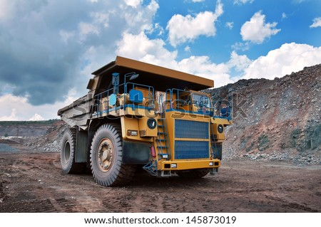 A picture of a big yellow mining truck at work site - stock photo