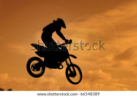 A picture of a biker making a stunt and jumps in the air - stock photo