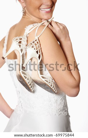 A picture of a bride and her worn-out shoes after the wedding party - stock photo
