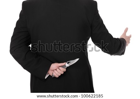 A picture of a businessman hiding a knife behind his back and greeting somebody over white background - stock photo