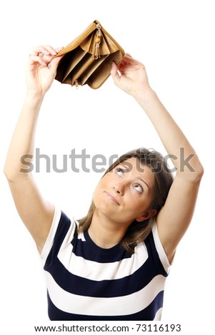 A picture of a cute girl standing against white background with an empty wallet - stock photo