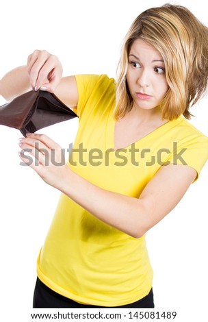 A picture of a cute girl standing against white background with an empty wallet, surprised  - stock photo