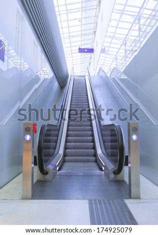 A picture of a escalatur on a railwaystation - stock photo