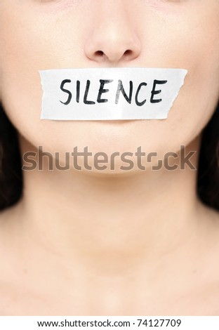 "A picture of a female face with a tape on her mouth and a notice ""silence"" - stock photo"