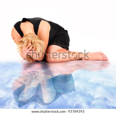 A picture of a frustrated woman and her water reflection lying over white background - stock photo