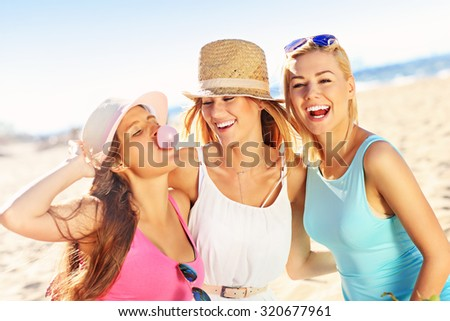 A picture of a group of friends having picnic on the beach - stock photo