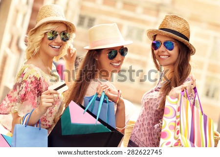A picture of a group of friends window shopping in the city - stock photo