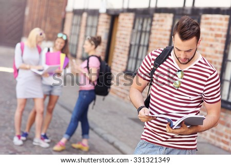 A picture of a group of students standing in the campus - stock photo