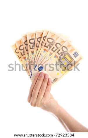 A picture of a hand holding euro fifty-euro notes over white background - stock photo