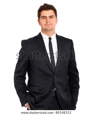 A picture of a handsome confident businessman standing over white background