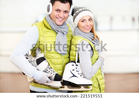 A picture of a happy couple in the ice rink - stock photo
